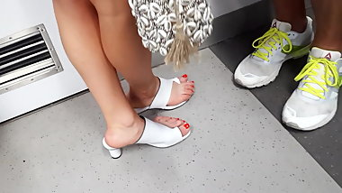 Candid close up her sexy feets arches, red toes
