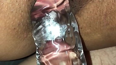 Wife taking a cock sleeve with a vibrator on clit