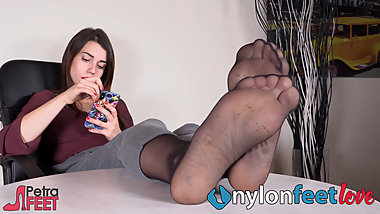Feet in nylons in your face while she ignores you