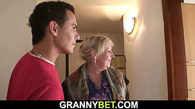 Big tits blonde granny spreads legs for him