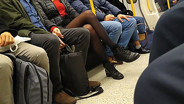 Long pantyhose legs in London underground
