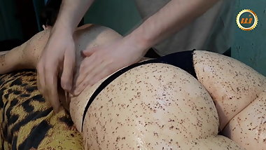 Massage with scrub. Sexual skin cleansing