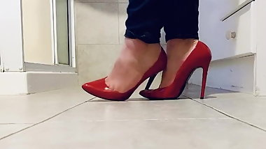 Playing in her red stilettos