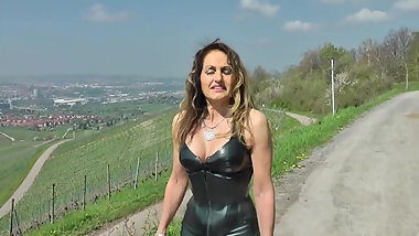 Sexy Milf in shiny Tight leather and high heels