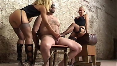 Slave Subjected To Cruel Handjob By 2 Mistresses